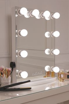 simplistic crisp white finish embedded hollywood light up mirror with ten LED bulbs
