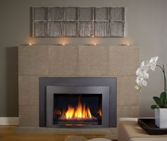 This is our 'Minneapolis' gas insert fireplace. More information visit us at www.kozyheat.com/products