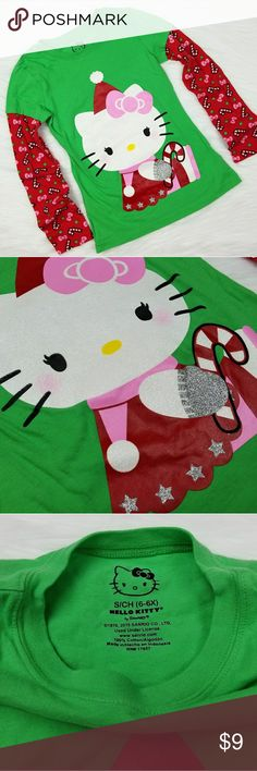 Hello Kitty Christmas Long Sleeve Shirt S 6/6X Hello Kitty Christmas Long Sleeve Shirt   🔹️Brand: Hello Kitty by Sanrio   🔹️Size: S 6/6X 🔹️Condition: Excellent Condition. Washed but never worn. No holes, rips or stains. Sanrio Shirts & Tops Tees - Long Sleeve