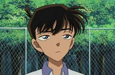 Well, Shinichi here wants to give up on the badminton game he and Ran was playing. I liked the photo because his face is cute!! That's all that I wanna say, thank you. :)