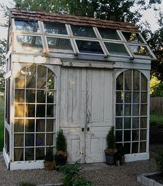 Cutest little garden shed/studio made from all recycled doors, windows, trim. Home decor via | Hippies Hope Shop