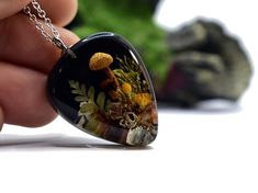 Excited to share this item from my #etsy shop: Real mushroom Necklace, Mushroom And Moss pendant, Resin Jewelry, Resin and Mushroom, Unique Gift, Australian Gift, Forest jewellery #realmushroom #mushroomjewellery #mushroomandmoss #realmoss #mushroomjewelry Wild Mushrooms, Stuffed Mushrooms, Clear Casting Resin, Australian Gifts, Resin Jewelry, Jewellery, Black Backgrounds, Unique Gifts, Gemstone Rings