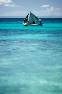 Head out for a snorkel and meet some locals. This fisherman's sailboat was anchored just off the coast of Labadee.
