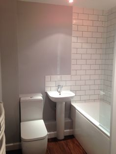 Grey & white bathroom with London Underground tiling Gray And White Bathroom, Grey And White, London Underground, Tiling, Bathroom Ideas, Basement, Toilet, New Homes, Dreams