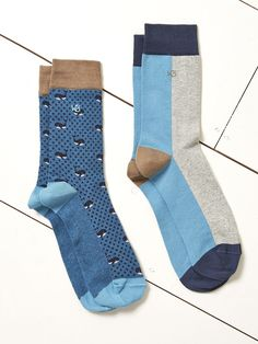 Show your feet a whale of a time in these cotton-rich socks. The first pair features a whale and spot design the second colour blocked stripes. Both pairs have contrasting ankles heels and toes.