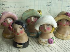the gals by noodle and lou, via Flickr-don't know if they are ceramic or mache