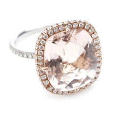Cushion-Cut Morganite and Diamond Micropave Ring by Greenwich Jewelers    PRICE:  $7,000  METAL:  Gold, Platinum  TYPE OF CENTERSTONE:  Diamond, Other  CARAT WEIGHT OF CENTERSTONE:  Over 5  OVERALL CARAT WEIGHT:  Over 5  CUT:  Cushion  CLARITY:  VS1  AVAILABLE AT:   Greenwich Jewelers  64 Trinity Pl. , Financial/Battery Pk  212-964-7592