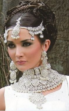 "Stunning as an example of ""sometimes you CAN wear too much bling""! But individually?  Stunning!"
