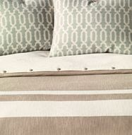 Eastern Accents Bedding: Bands of ivory run across bottom half of a beige duvet. Linen textures and graphic trellis design on the duvet and boudoir combine effortlessly with the soft spa coloration