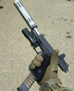 darksage132:  Suppressor, extended mag, optics, and a tac light/laser…pure eye candy.