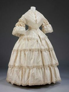 1857 English silk wedding dress with buckram trimming from the V A museum.