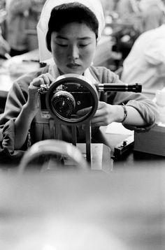 Rene Burri  JAPAN. Tokyo.  Nikon camera assembly line. 1961.