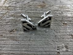 https://www.etsy.com/listing/476282600/superman-steel-cufflinks-silver-color?ref=shop_home_active_26