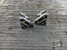 https://www.etsy.com/listing/476282600/superman-steel-cufflinks-silver-color?ref=shop_home_active_26