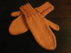 coral knitted mittens with button detail