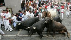 """""""You mess with the bull, you get the horn"""" Join the world-famous encierro to run like hell and celebrate the religious festival to honor St. Fermin, the patron Saint of Pamplona. Pamplona, Spain    #JetsetterCurator"""