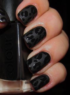 Black leopard print or Animal print nail art in matte