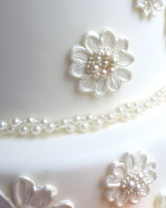 3 tier wedding cake, Especially For You! | Karen's Cakes. These are fondant and royal icing appliqué lace pieces with edible pearl centres.