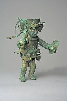 Warrior Figure Date: 390–450 Geography: Peru Culture: Moche (Loma Negra) Medium: Gilded copper, shell, stone