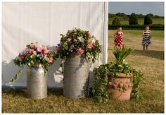 Milk cans and flowers