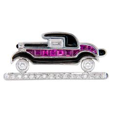 Onyx Ruby Diamond Car Brooch | From a unique collection of vintage brooches at http://www.1stdibs.com/jewelry/brooches/brooches/