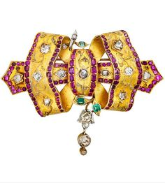 JEWELLED 18K RIBBON BOW BROOCH WITH DIAMONDS. Bloomed 18k gold ribbon brooch with platinum accents, set with colourless and fancy colour diamonds, emeralds and rubies. Probably Italian, circa 1885. #antique #brooch