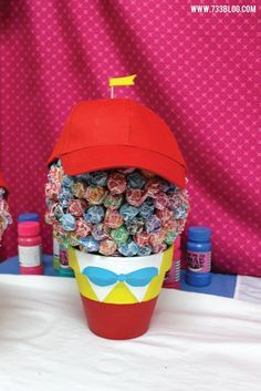 Tweedle Dee and Tweedle Dum Dum-Dum Topiary Idea - Easy to make and perfect for an Alice in Wonderland Party - Follow the pin to get more information on this inexpensive DIY Alice in Wonderland Birthday Party!