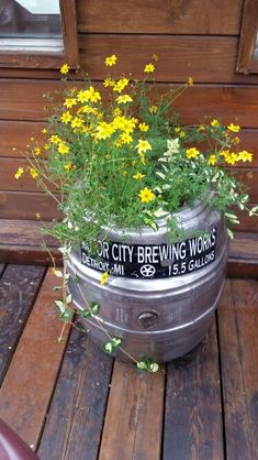 I love this idea!  Beer keg planter.