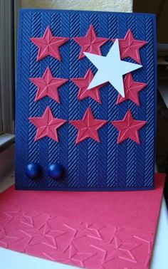 handmade Fourth of July card ... CAS123 Patriotic Stars by ruby-heartedmom ... embossing folders make the card ... herringbone on blue for stripes ... red textured stars cut from embossing folder of stars ... like this clean and simple card ...