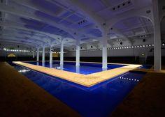 Rem Koolhaas floats Prada SS15 catwalk on blue pool