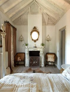 European beach house photographed by Enrique Menossi; shabby chic bedroom, exposed beams, all cream everything interiors