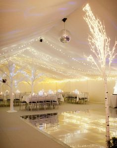 Winter wonderland party created here using an LED Starlight ceiling, LED faux trees and warm white string lights throughout all reflected in the mirrored dance floor and lit with ice blue gels in the uplighters and spotlights. A truly magical Marquee transformation for this 21st birthday party.