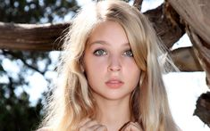 Beautiful blonde girl with green eyes portrait wallpaper