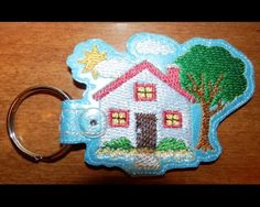 Home Key Fob  This Key Fob sews in the 4x4 hoop on any light colored.  This design is very detailed and stitch heavy for a key fob, so be sure and use plenty of stabilizer. I also recommend using wss on top.  This item is perfect for use as a zipper pull, a backpack charm or a key fob!!  Available Formats Include - DST, PES, PEC, HUS, JEF, VIP, VP3, and EXP  You may make this design as many times as you like, and you may sell your finished key fobs, however, please do not modify, share or…