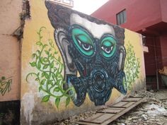 This mural of a Buddha-like face covered in a gas mask sprouting leaves, by artist Yantr, faces a heavily congested intersection in Khirki village. Used as a thoroughfare to get to a major shopping mall near the village, it is known for being a particularly polluted spot located between the urban and the semi-rural.