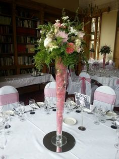 Conical Vase with pink stem and natural arrangement, by Lily King Weddings
