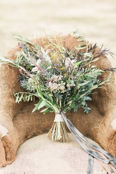 wildflower bouquet - photo by Lauren Fair Photography http://ruffledblog.com/bohemian-wildflower-wedding-inspiration