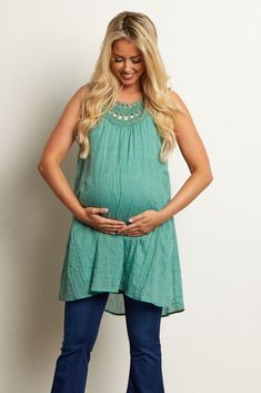 This lightweight maternity tank top is the perfect piece to keep you stylishly cool this season. A pretty crochet neckline gives this top the perfect feminine detail for any occasion. Style this top with maternity jeans and wedges for a gorgeous ensemble. Pregnancy Looks, Pregnancy Outfits, Pregnancy Style, Maternity Outfits, Pregnancy Fashion, Maternity Clothing, Maternity Pictures, Maternity Tunic, Stylish Maternity