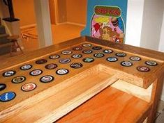 bar top ideas | Bar top includes full sized imbedded hockey pucks! How cool is that?