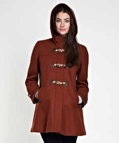 Posh, polished and timelessly alluring, this hooded coat is a perfect pick for chilly days. Boasting a luxurious woolen blend with lavish leather trim, this coat adds classic sophistication to any ensemble.80% wool / 20% polyamideLining: 50% acetate / 50% viscoseTrim: 100% leatherDry cleanImported