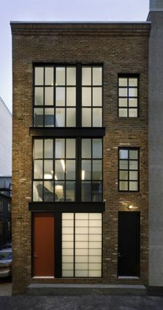 Townhouse.     Old english Industrial references. Appreciate factory windows with contemporary translucent glazing.