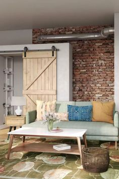 View this Industrial, Farmhouse living room design from Havenly interior designer Haley. Shop products and even get started designing your own space.