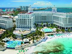 Riu Palace Las Americas (Cancun, Mexico  This 5-star  resort is known for its exceptional service, quality and luxury. From the minute you step foot into this beautifully crafted and designed resort, you will be pampered and revitalized by the calming Caribbean Sea and the top quality amenities that await you. Bathe in the amazing infinity pool or bask in the sun on the white sand beach with an unobstructed view of Isla Mujeres.    Book now: www.allinclusiveresorts.com