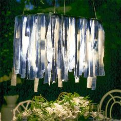 Indigo-dipped cotton strips glued to a white frame with battery-powered string lights.