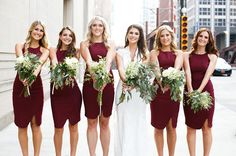 Bridesmaids in pretty fitted marsala dresses