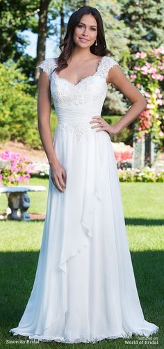 A slim A-line gown with a sweetheart neckline, natural waistline, and chiffon flutter in the front of the skirt. The ruched cummerbund and lace up back cinch your waist and your figure is further elongated by the chapel length train for an overall flattering look.
