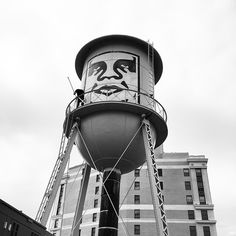 One of Shepard Fairey's Andre the Giant wheatpaste posters on a water tower in Detroit last month. (photo by obeygiant/Instagram)