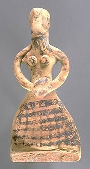 Indus Valley - Early Harappan female figurine holding a bowl in her two hands. The face is painted with bold eyes and a necklace with pendant beads is painted at the throat. The lower body is decorated with cross hatched painted design that may indicate the patterns of ancient Indus textiles.