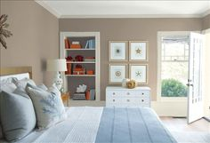 Look at the paint color combination I created with Benjamin Moore. Via @benjamin_moore. Wall: Weimaraner AF-155; Trim: Wind's Breath OC-24; Bookcase Back Wall: Silhouette AF-655; Ceiling: White Heron OC-57.