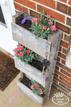 Pallet turned planter to attract butterflies.